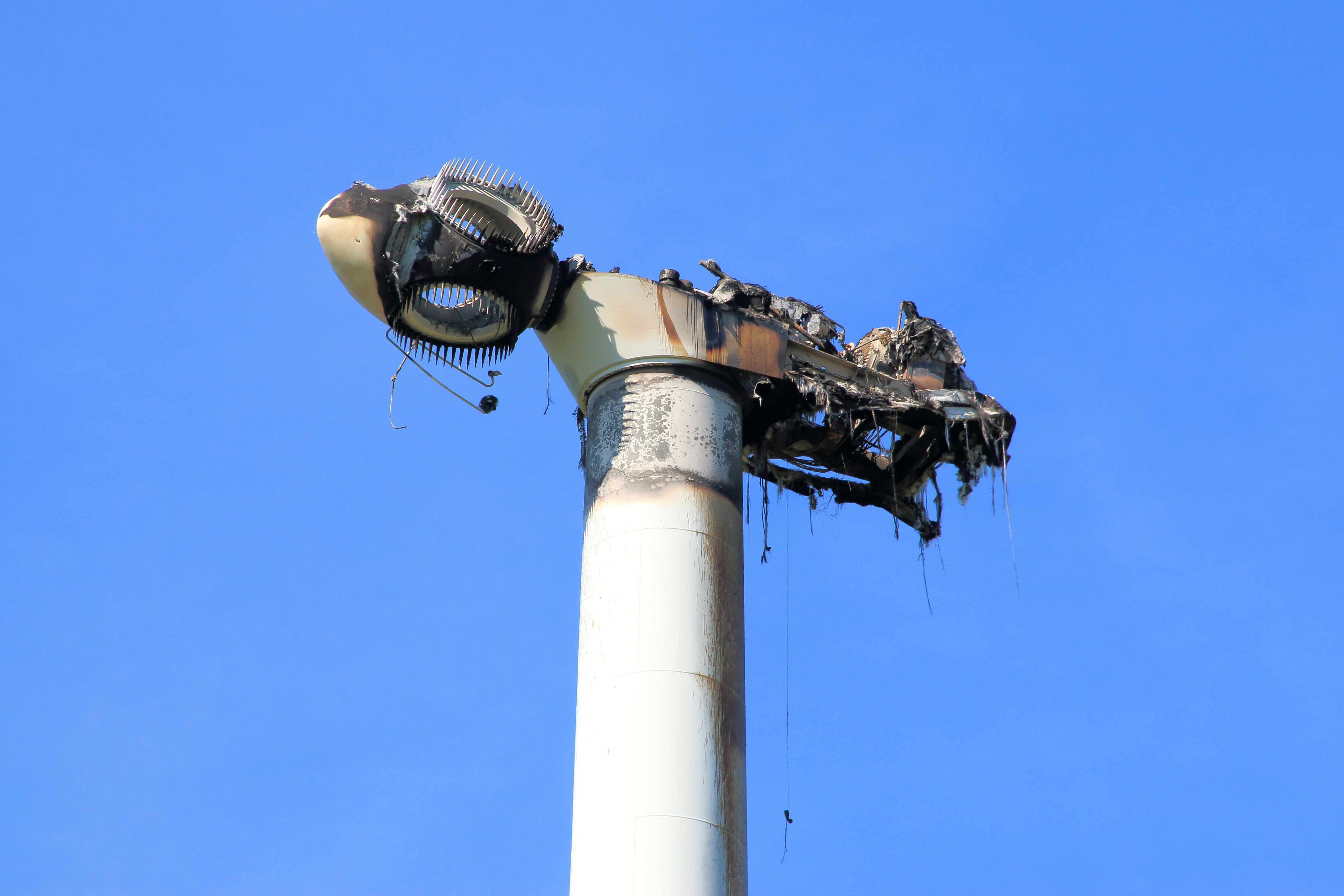 burned windmill, destroyed nacelle by fire-Shutterstock_ 1231008466