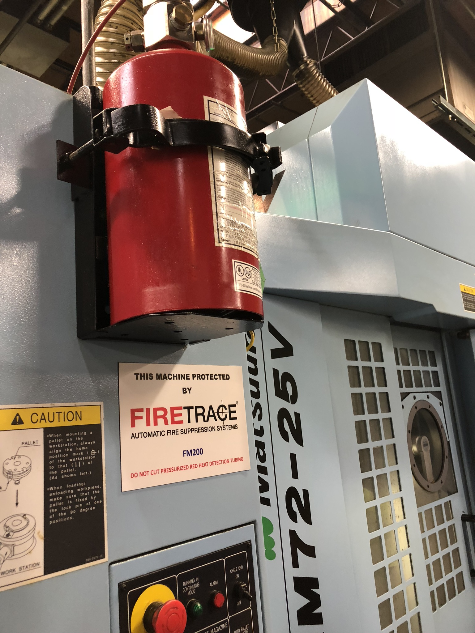 CNC Grinder - This Machine Protected by Firetrace